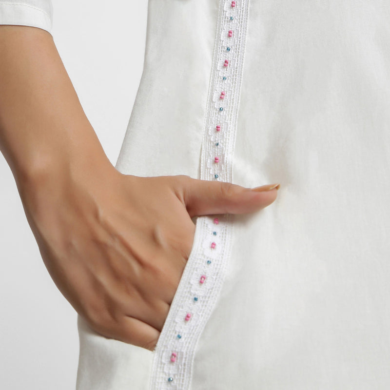 Right Detail of a Model wearing White Hand Beaded Button-Down Dress