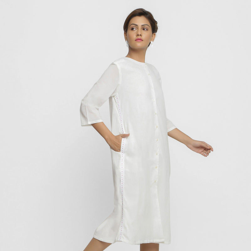 Right View of a Model wearing White Hand Beaded Button-Down Dress