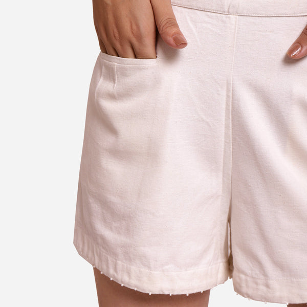 Front Detail of a Model wearing White Hand Beaded Short Cotton Shorts