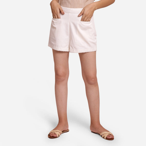 Front View of a Model wearing White Hand Beaded Short Cotton Shorts