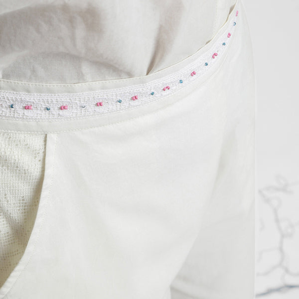 Front Detail of a Model wearing White Hand-Beaded Straight Pant