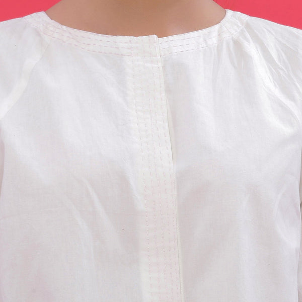 Front Detail of a Model wearing White Hand Embroidered Button-Down Top