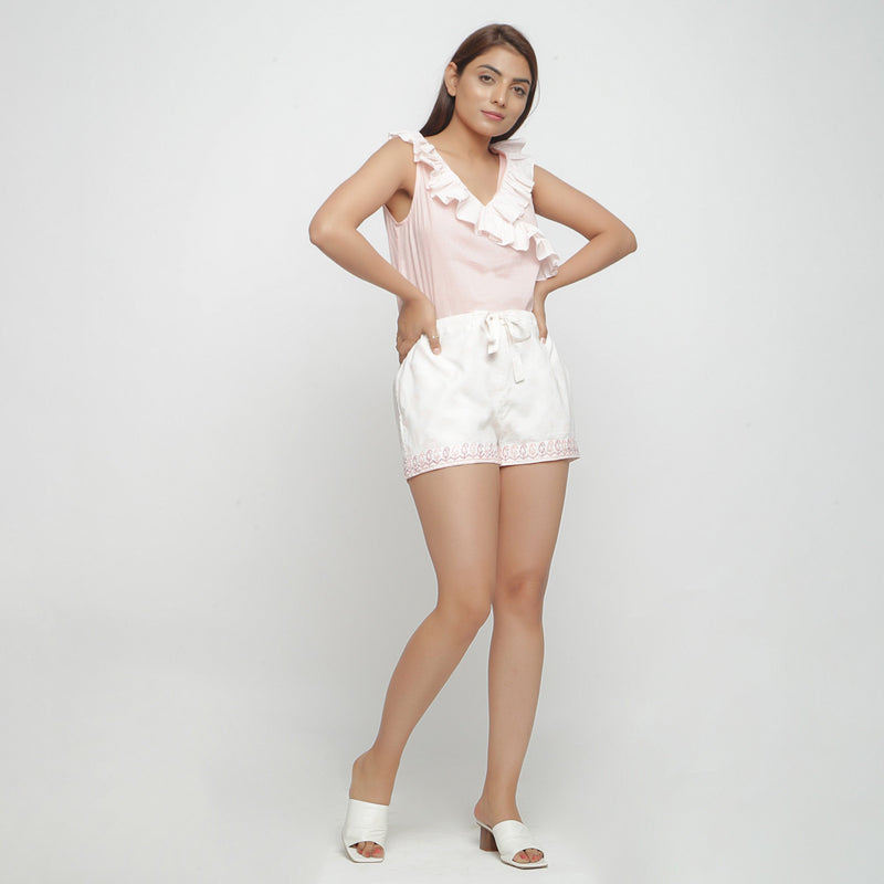 Front View of a Model wearing White Mid Rise Paisley Short Shorts