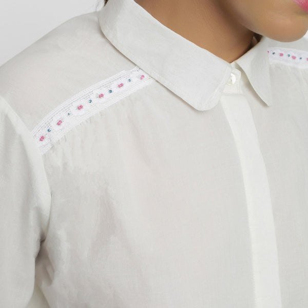 Front Detail of a Model wearing White Organic Cotton Button-Down Top