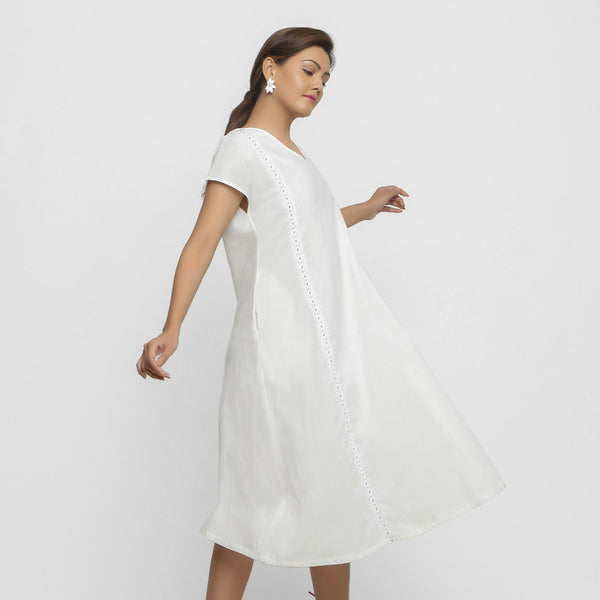 Right View of a Model wearing White Organic Cotton Hand Beaded Flared Dress