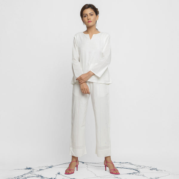 Front View of a Model wearing White Organic Cotton Top and Banded Hem Pant