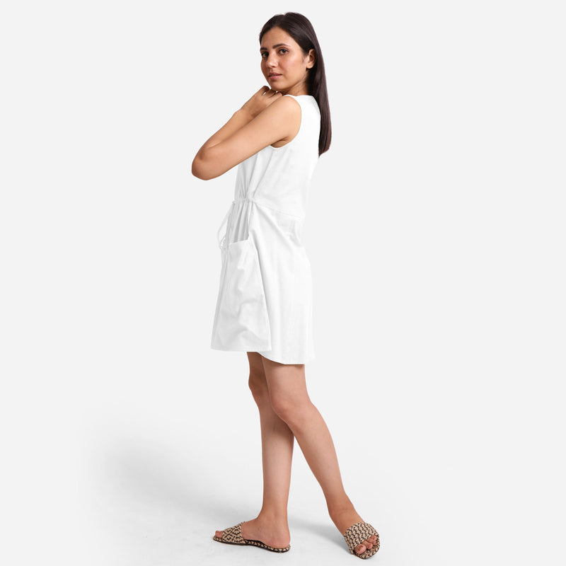 Left View of a Model wearing White Patch Pocket Round Neck Dress