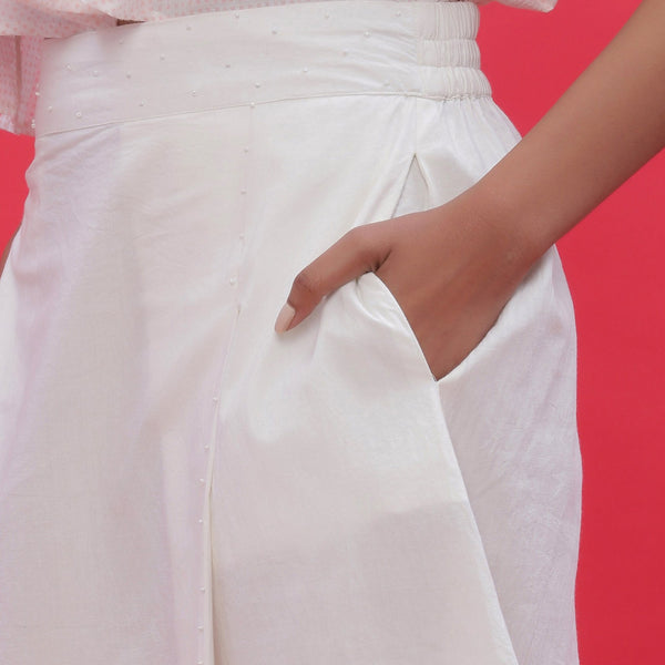 Front Detail of a Model wearing White Poplin Hand Beaded A-Line Skirt