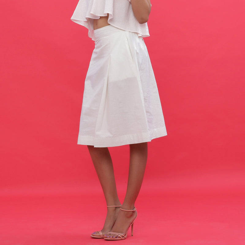 Left View of a Model wearing White Poplin A-Line Hand Beaded Skirt