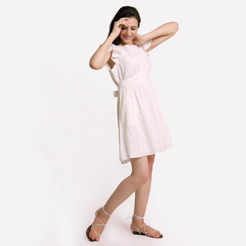 Right View of a Model wearing White Princess Line Backless Short Dress