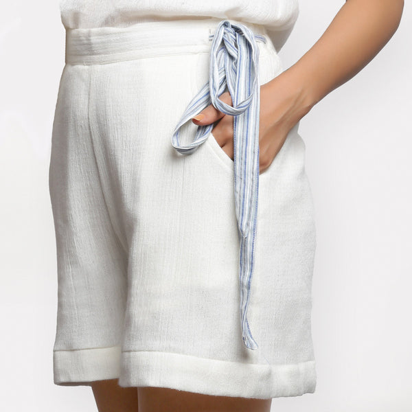 Left View of a Model wearing White Short Crinkled Cotton Shorts