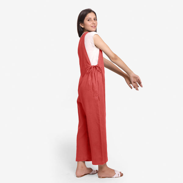 Right View of a Model wearing White Straight Top and Brick Red Jumpsuit Set