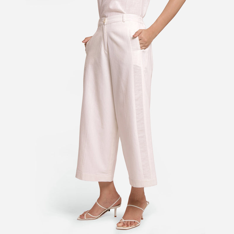 Left View of a Model wearing Solid White Wide Legged Straight Pant