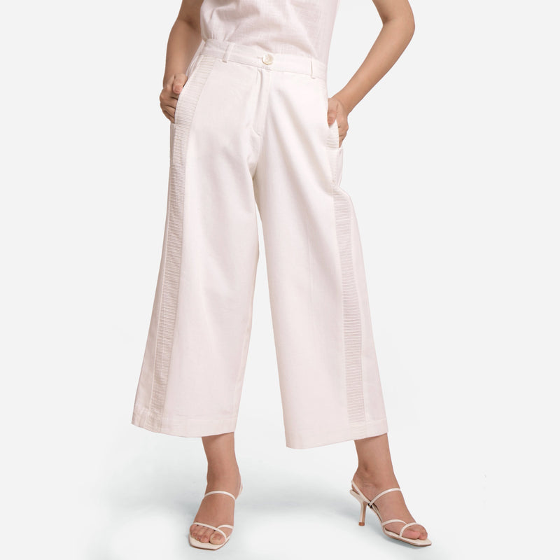 Front View of a Model wearing Solid White Wide Legged Straight Pant