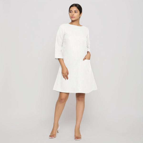 Front View of a Model wearing White Yoked Cotton Tunic Dress