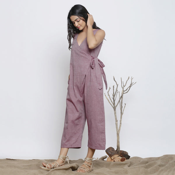 Left View of a Model wearing Wine Handspun Deep Neck Wrap Jumpsuit