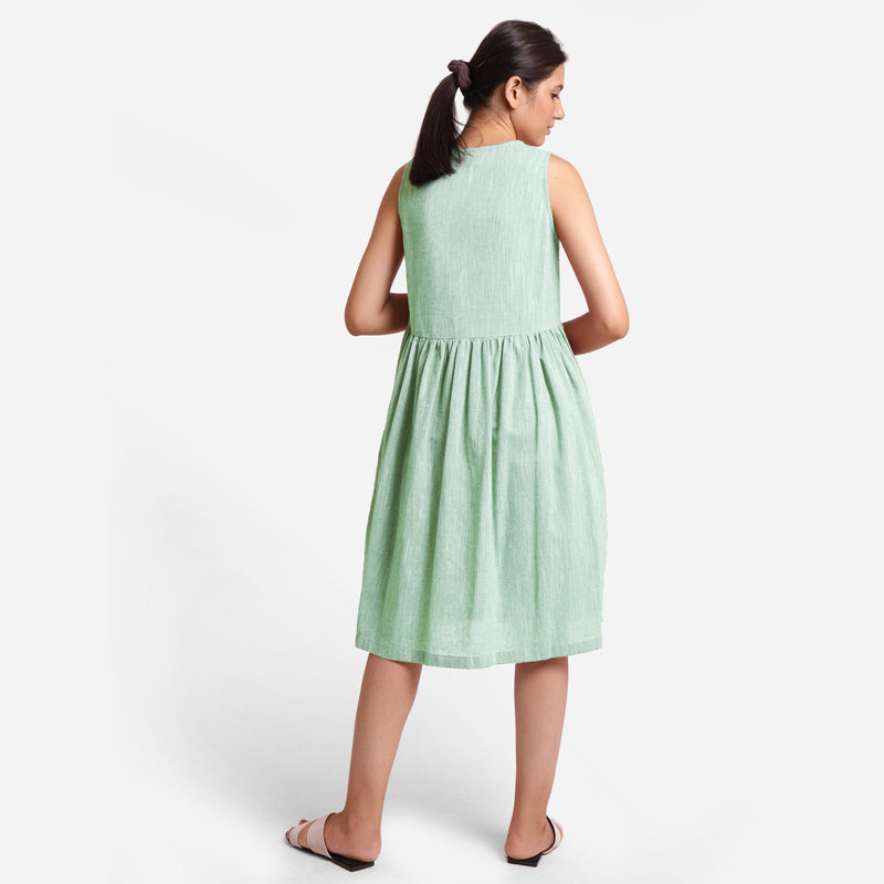 Back View of a Model wearing Yarn Dyed Cotton Aqua Yoke Dress
