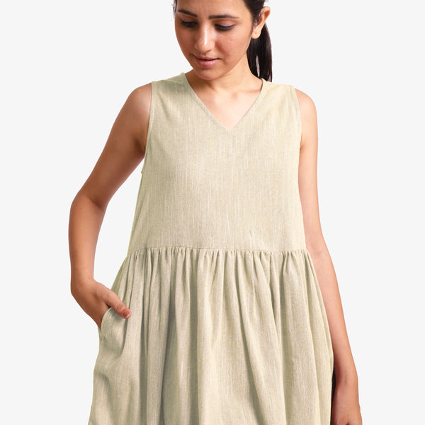 Front Detail of a Model wearing Yarn Dyed Cotton Beige Yoke Dress