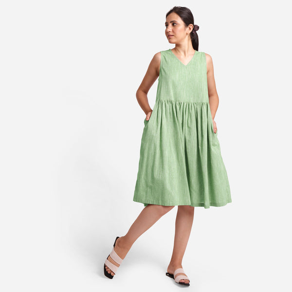 Front View of a Model wearing Yarn Dyed Cotton Green Yoke Dress