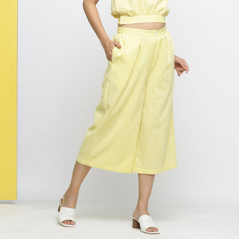 Right View of a Model wearing Yellow Yarn Dyed Cotton Flared Culottes