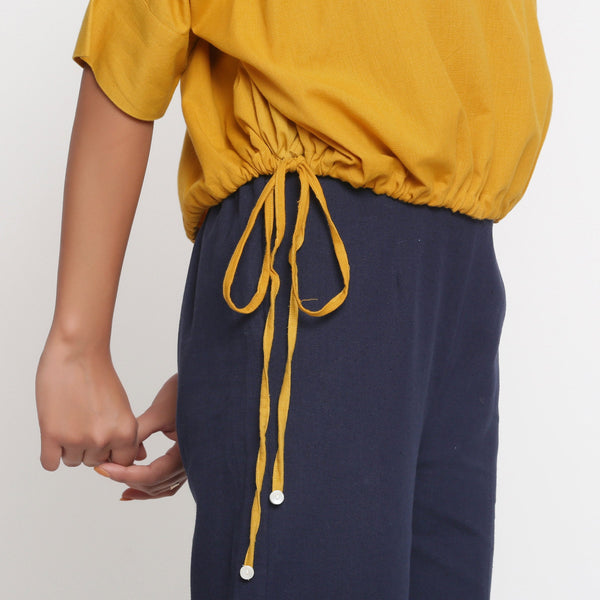 Right Detail of a Model wearing Yellow Cotton Flax Blouson Top