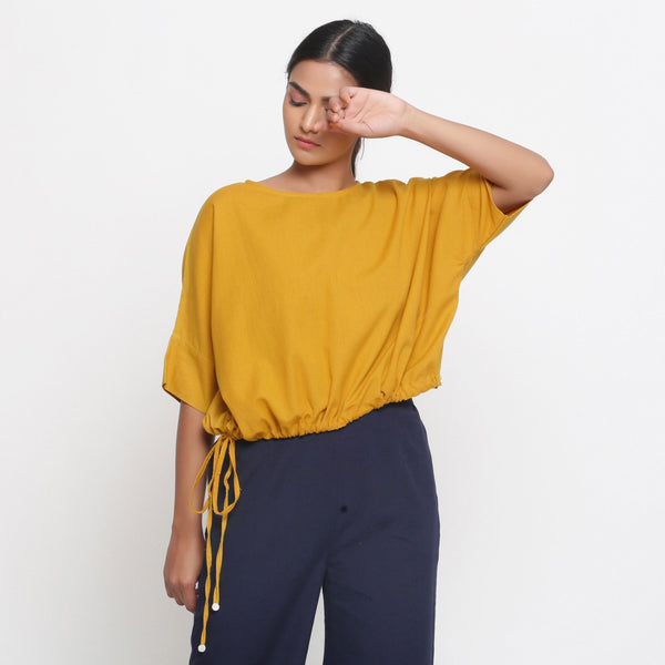 Front View of a Model wearing Solid Yellow Cotton Flax Blouson Top
