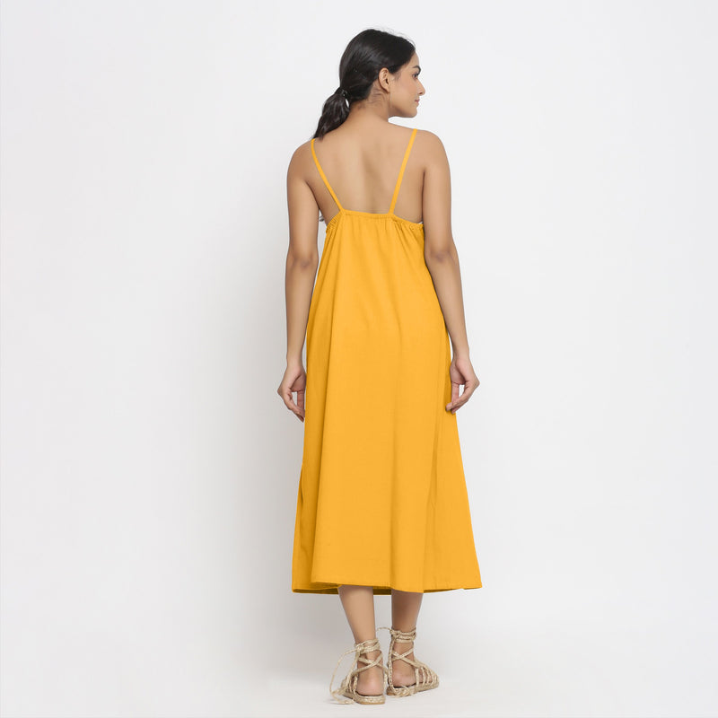 Back View of a Model wearing Yellow Cotton Flax Strap Sleeve A-Line Dress