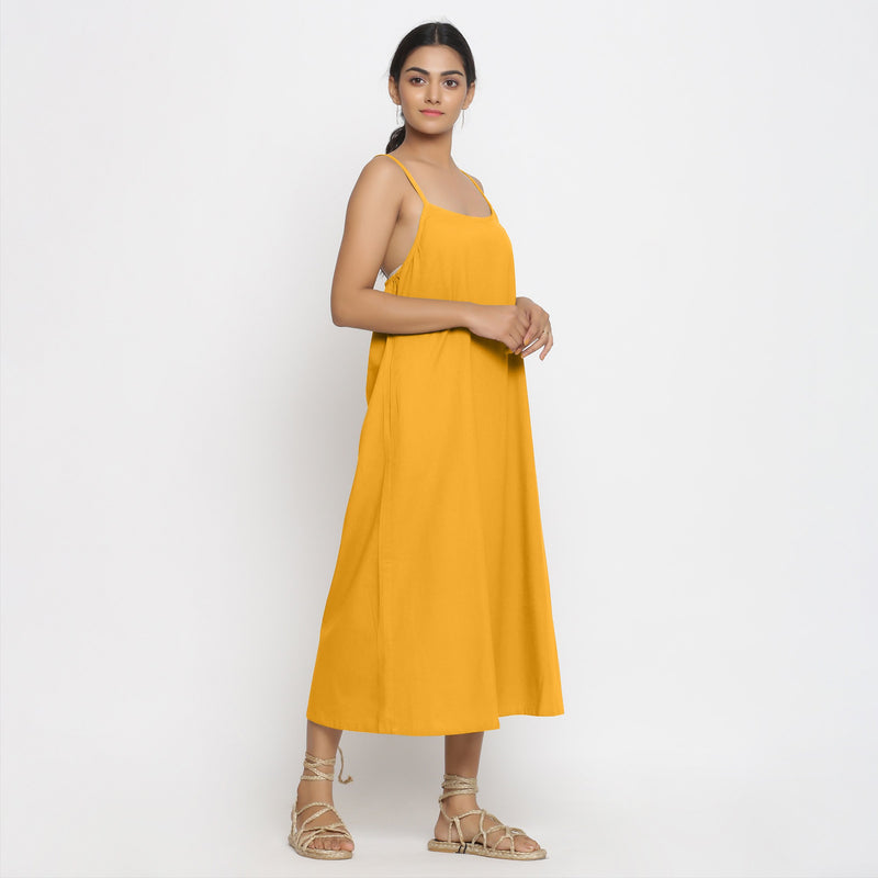 Right View of a Model wearing Yellow Cotton Flax Strap Sleeve A-Line Dress