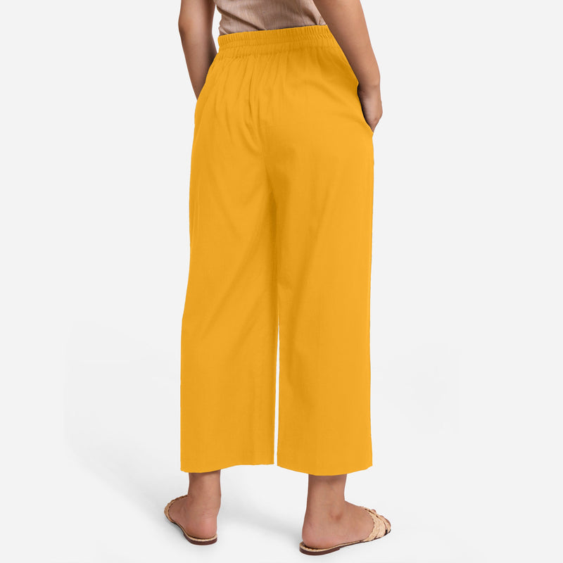 Back View of a Model wearing Yellow Cotton Flax Wide Legged Pant