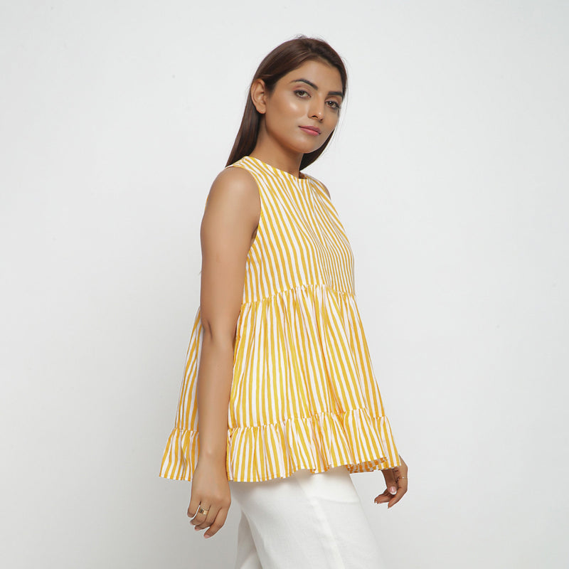 Right View of a Model wearing Yellow Tiered Hand Screen Printed Top