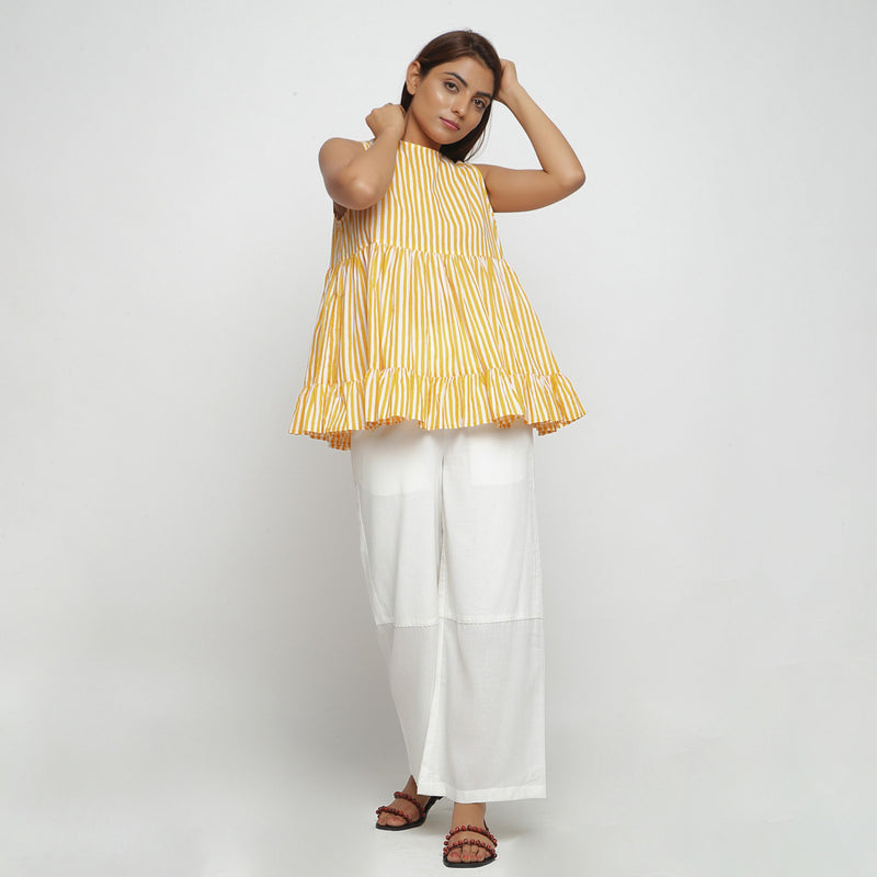 Front View of a Model wearing Yellow Tiered Hand Screen Printed Top