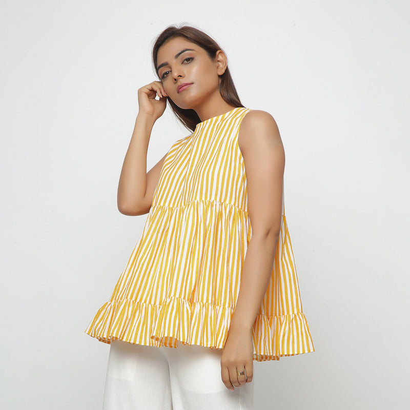 Left View of a Model wearing Yellow Tiered Hand Screen Printed Top