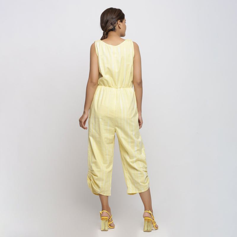 Back View of a Model wearing Yellow Hand Tie-Dyed Straight Jumpsuit