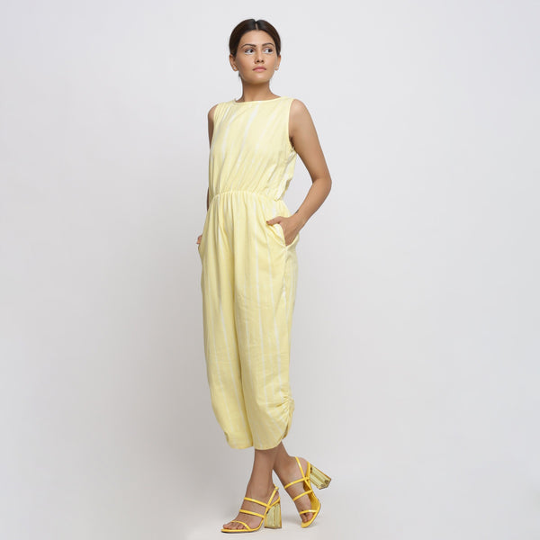 Left View of a Model wearing Yellow Hand Tie Dyed Straight Jumpsuit