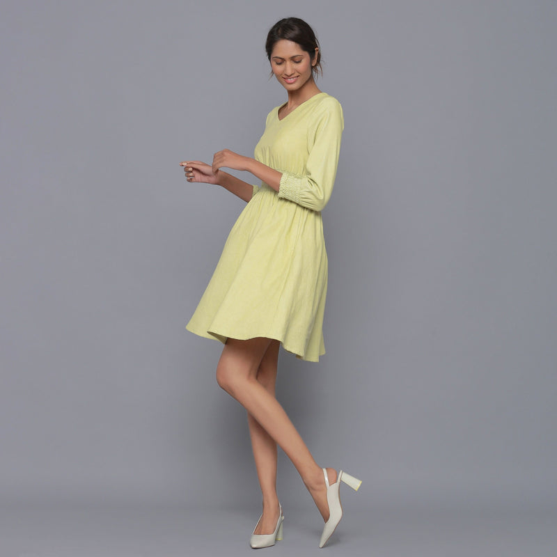 Left View of a Model wearing Yellow Pistachio V-Neck Corduroy Dress