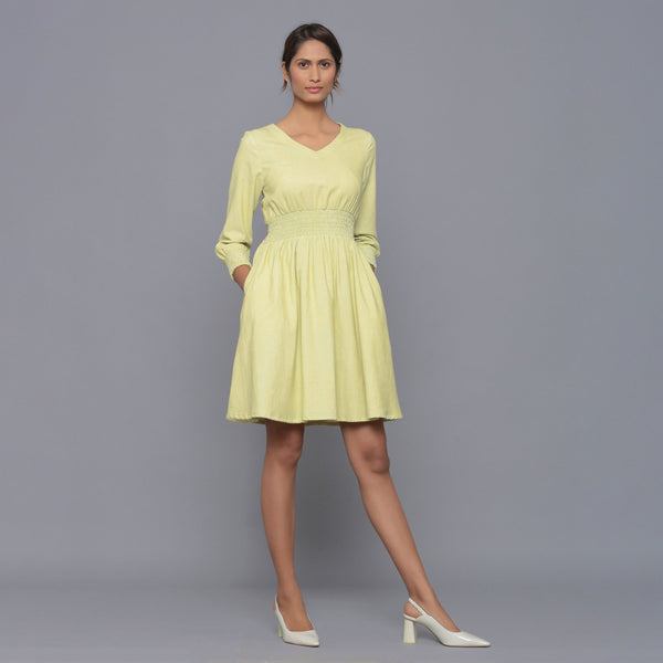 Front View of a Model wearing Yellow Pistachio V-Neck Corduroy Dress
