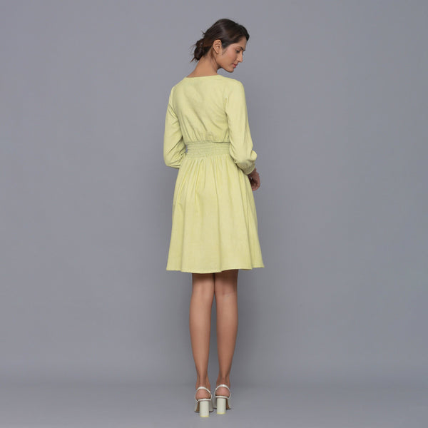 Back View of a Model wearing Yellow Pistachio Corduroy Elasticated Dress