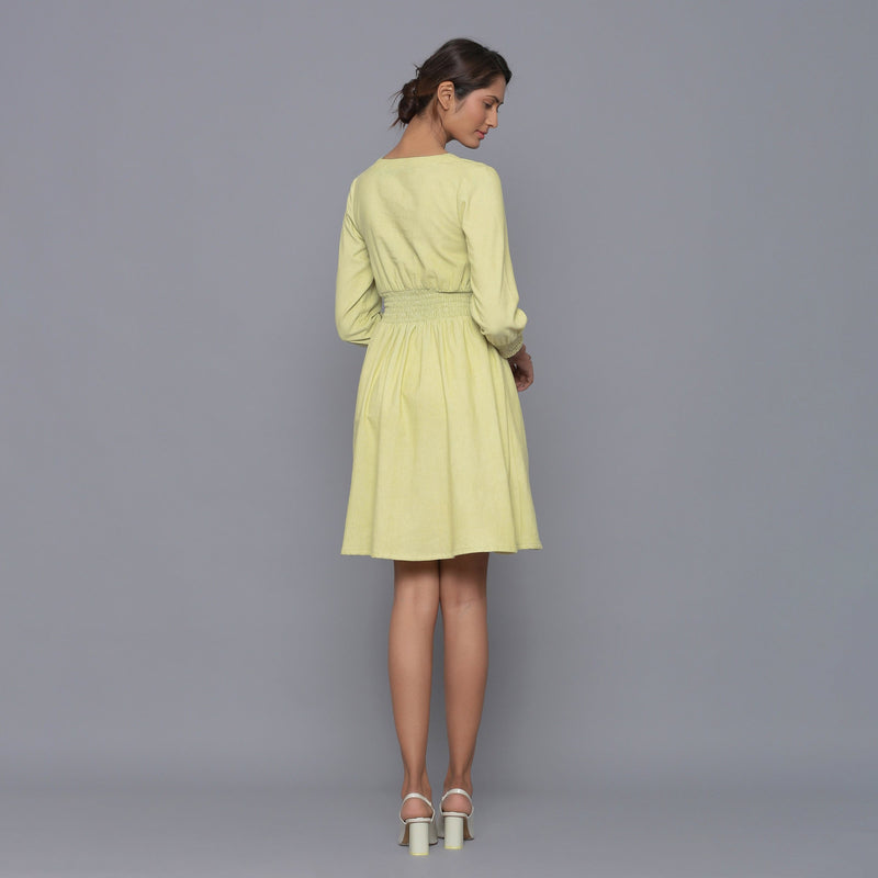 Back View of a Model wearing Yellow Pistachio V-Neck Corduroy Dress