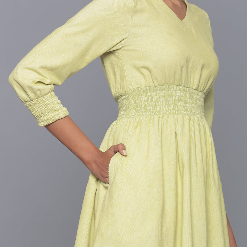 Right Detail of a Model wearing Yellow Pistachio V-Neck Corduroy Dress