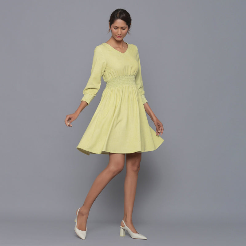 Right View of a Model wearing Yellow Pistachio V-Neck Corduroy Dress