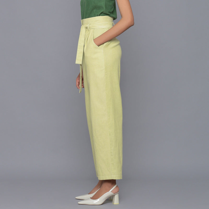 Left View of a Model wearing Yellow Pistachio Cotton Corduroy Pant