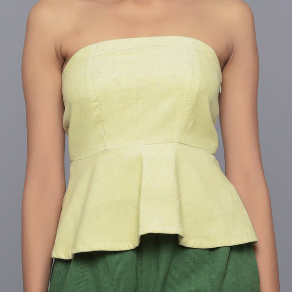 Front Detail of a Model wearing Yellow Pistachio Corduroy Peplum Top