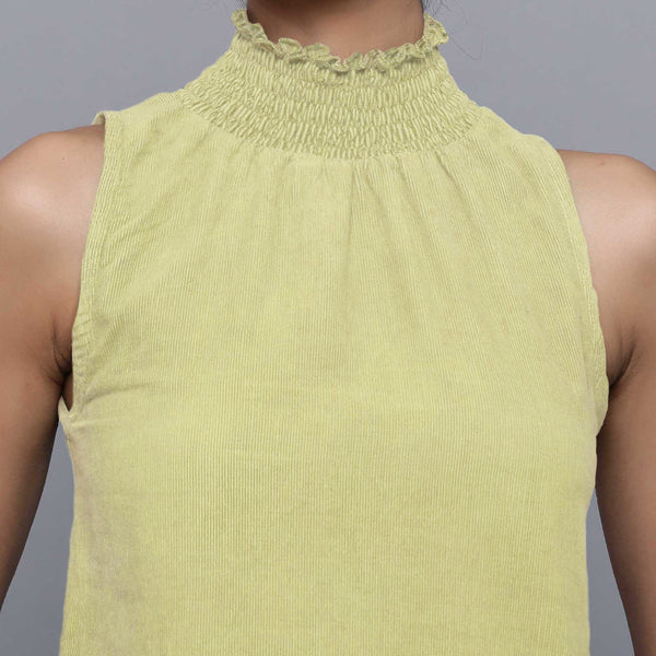 Front Detail of a Model wearing Yellow Pistachio Cotton Corduroy High Neck Top