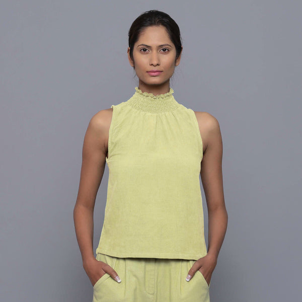 Front View of a Model wearing Yellow Pistachio Cotton Corduroy High Neck Top