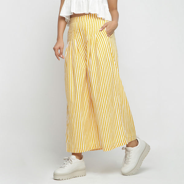 Left View of a Model wearing Yellow Striped Wide Legged Cotton Pant