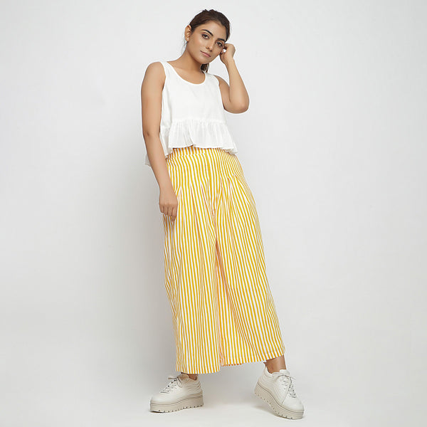 Front View of a Model wearing Yellow Striped Wide Legged Cotton Pant