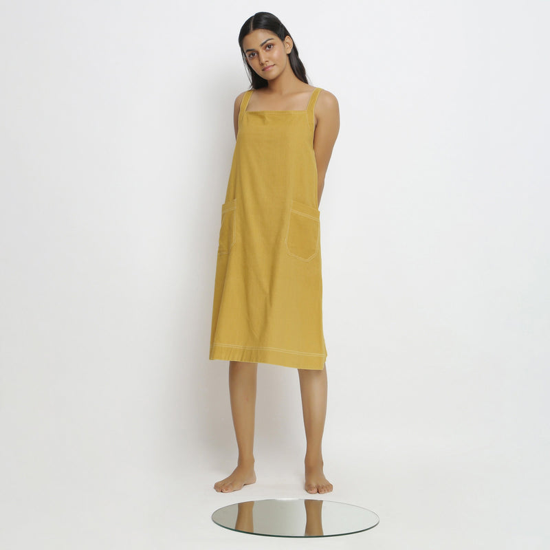 Front View of a Model wearing Yellow Vegetable Dyed Handspun Slip Dress