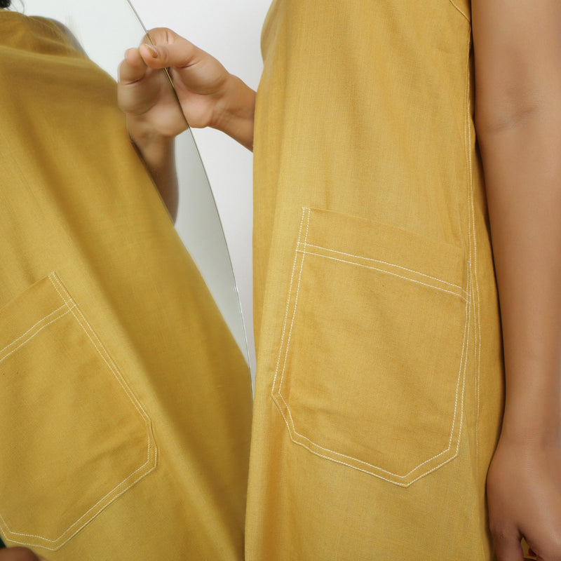 Close View of a Model wearing Yellow Vegetable Dyed Handspun Slip Dress