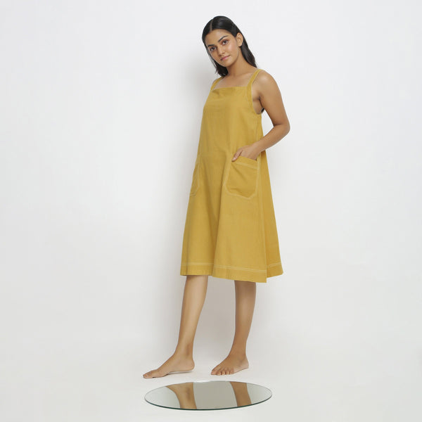 Left View of a Model wearing Yellow Vegetable Dyed Handspun Slip Dress