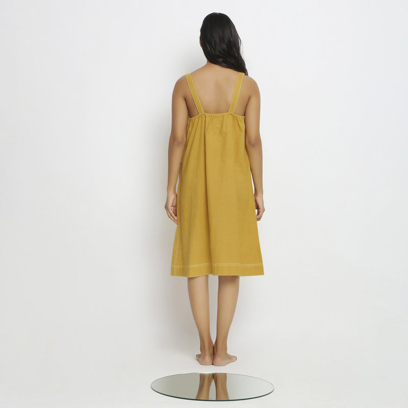 Back View of a Model wearing Yellow Vegetable Dyed Handspun Slip Dress